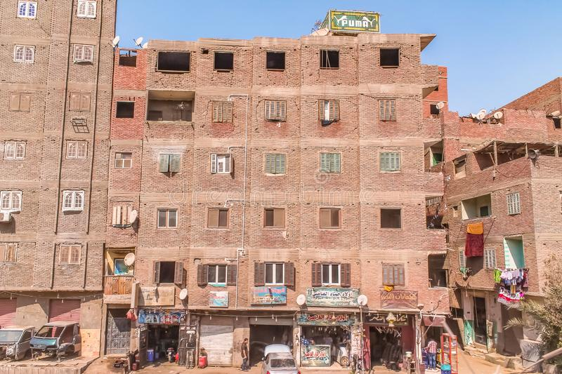The streets of Cairo are overcrowded with people and waste products and a huge population density. Cairo are overcrowded with people and waste products and a stock image