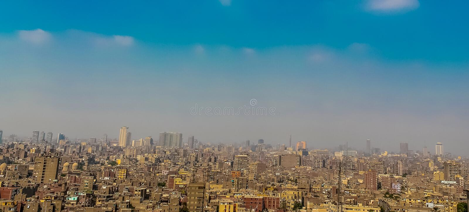 Panorama of Cairo overflowing with cars people and waste a huge population density. Cairo overflowing with cars people and waste a huge population density stock photography
