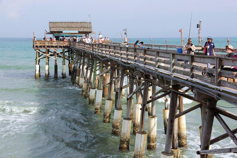 Cais da pesca da praia do cacau imagens de stock