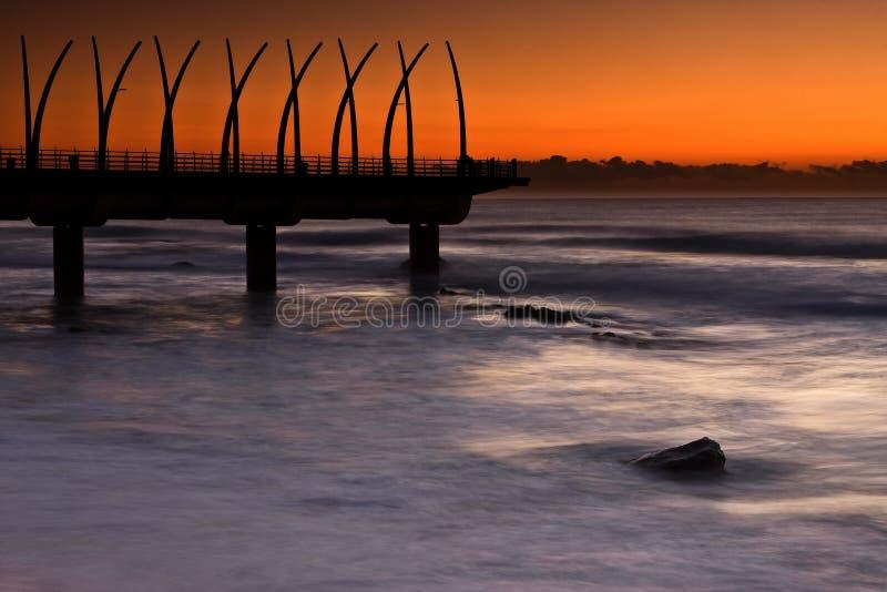 Cais do nascer do sol fotos de stock royalty free