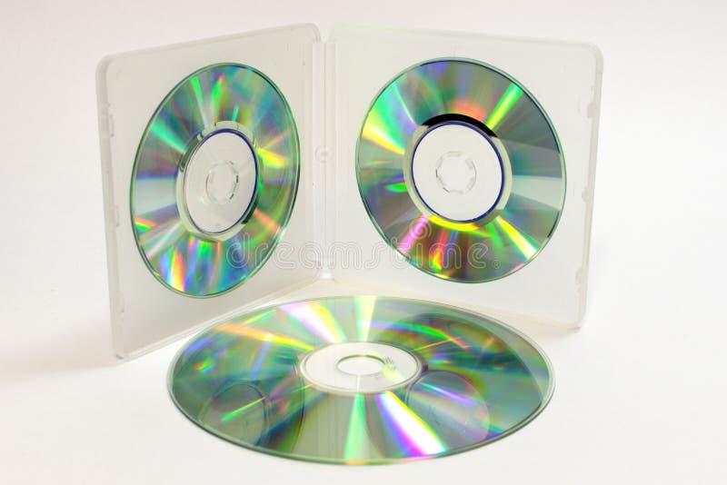 Caisse pour de mini Cd avec les disques iridescents photo libre de droits