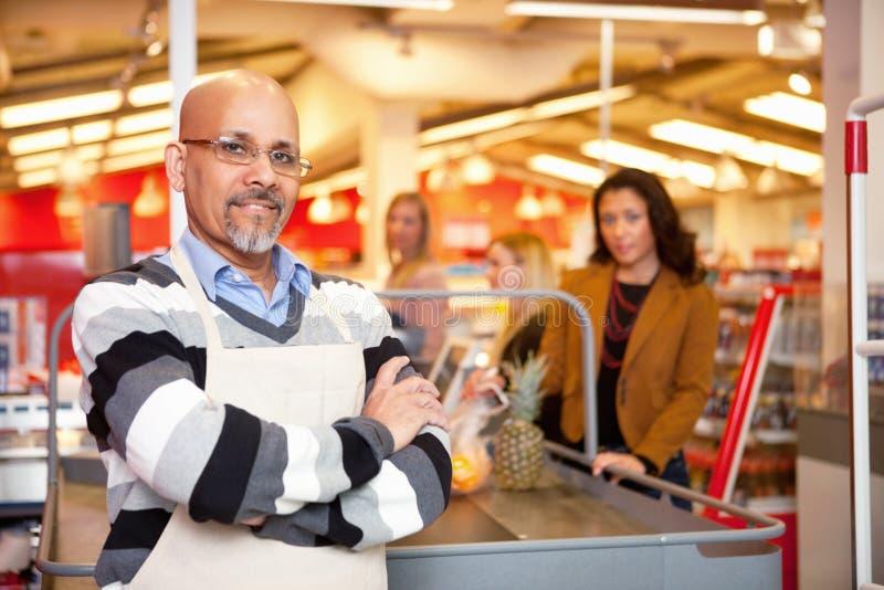 Caissier d'épicerie images libres de droits