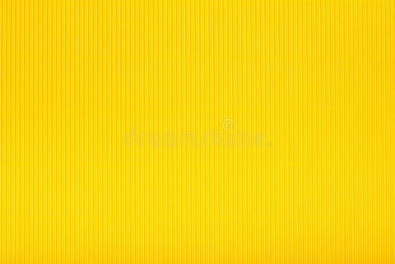 Caixa amarela do cartão ondulado, fundo da textura, colorido fotos de stock