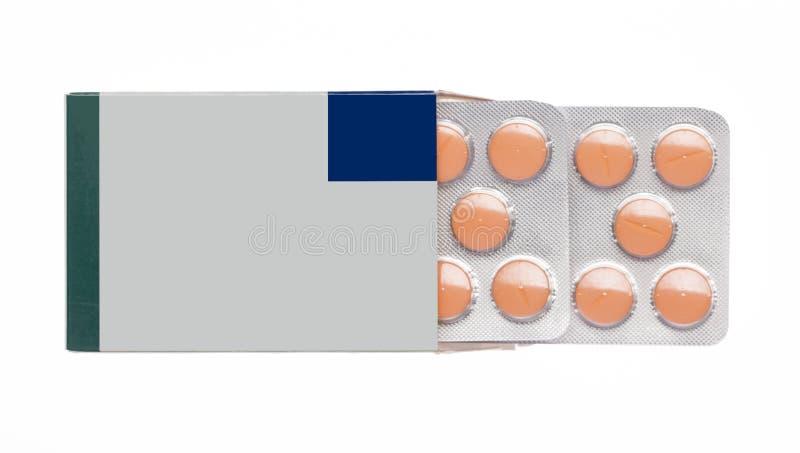 Caixa cinzenta com comprimidos alaranjados em um bloco de bolha fotos de stock royalty free