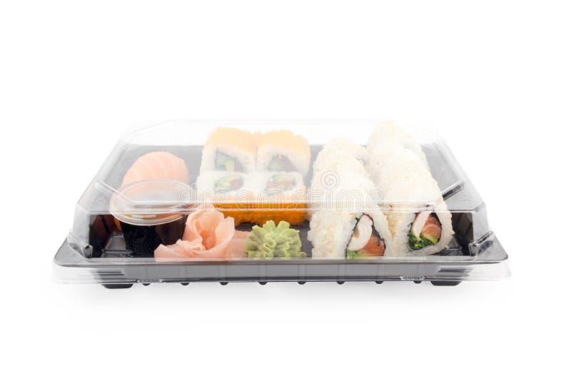 Caixa da entrega do sushi no fundo branco Menu de Japão na caixa preta do transporte fotografia de stock royalty free