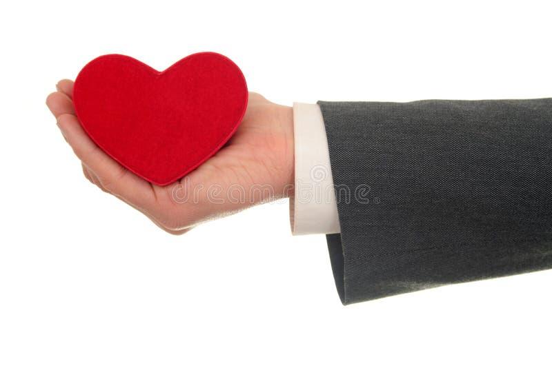 Caixa dada forma coração da terra arrendada da mão fotografia de stock royalty free