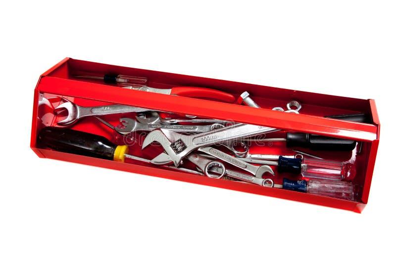 Caixa de ferramentas vermelha do metal com as ferramentas no branco imagens de stock