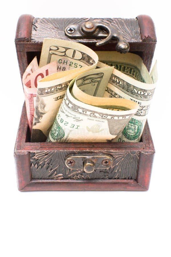 Caixa de madeira com dinheiro no branco fotografia de stock royalty free