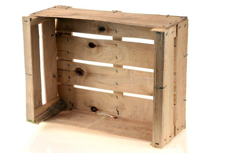 Caixa de madeira em um fundo branco fotografia de stock royalty free
