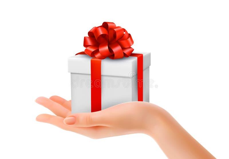 Caixa de presente à disposição com curva e as fitas vermelhas. ilustração stock