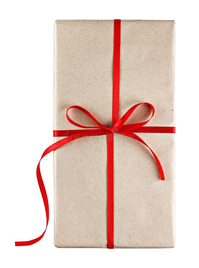 Caixa de presente amarrada com fita vermelha foto de stock