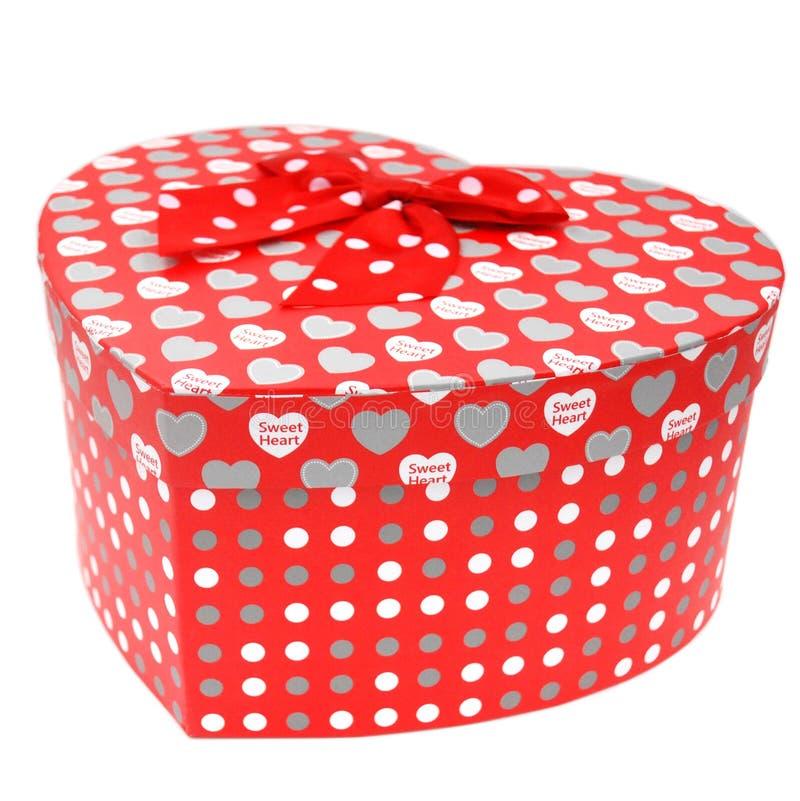 Caixa de presente dada forma coração com o laço fotos de stock