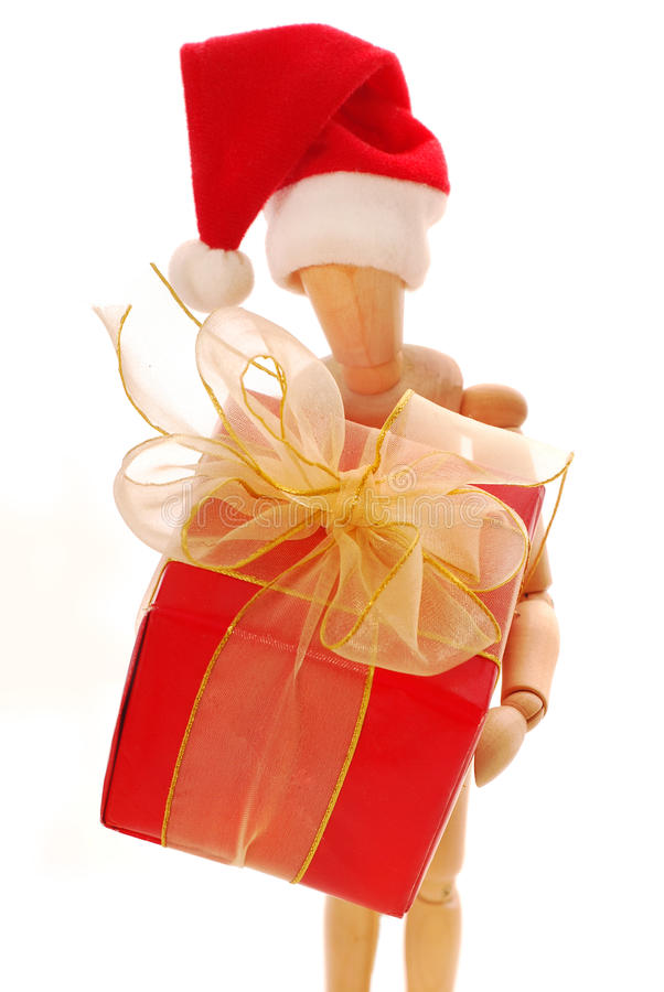 Caixa de presente de madeira do Natal da terra arrendada do mannequin imagem de stock