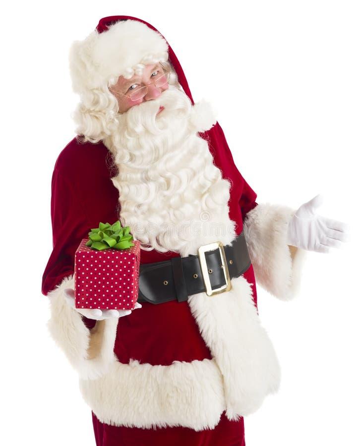 Caixa de Santa Claus Gesturing While Holding Gift fotografia de stock royalty free