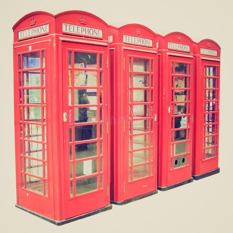 Caixa de telefone retro de Londres do olhar fotografia de stock
