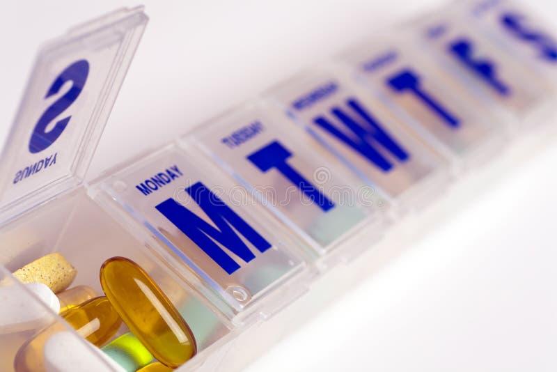 Caixa do comprimido com vitaminas imagem de stock royalty free