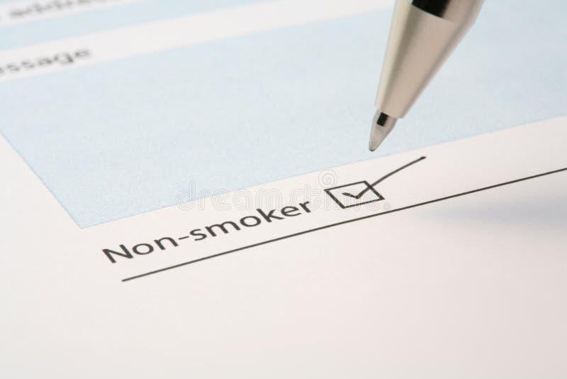 Caixa do tiquetaque do não fumador em um formulário imagem de stock royalty free