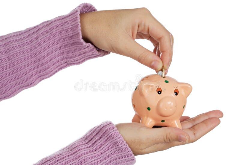 Caixa e moedas de dinheiro imagens de stock