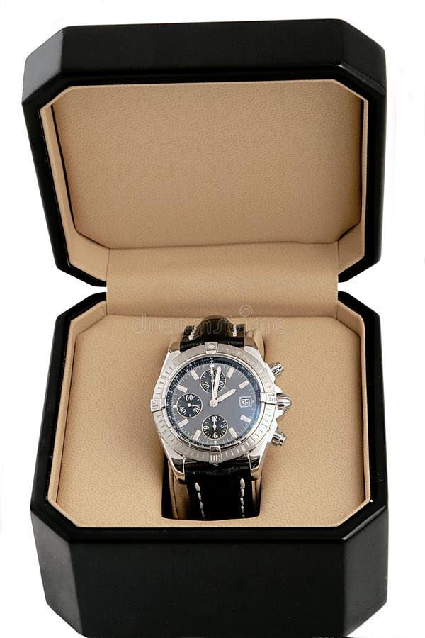 Caixa negra com relógio luxuoso foto de stock royalty free