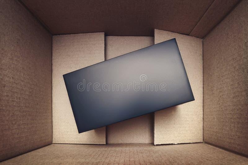 Caixa negra na opinião superior da caixa fotos de stock royalty free