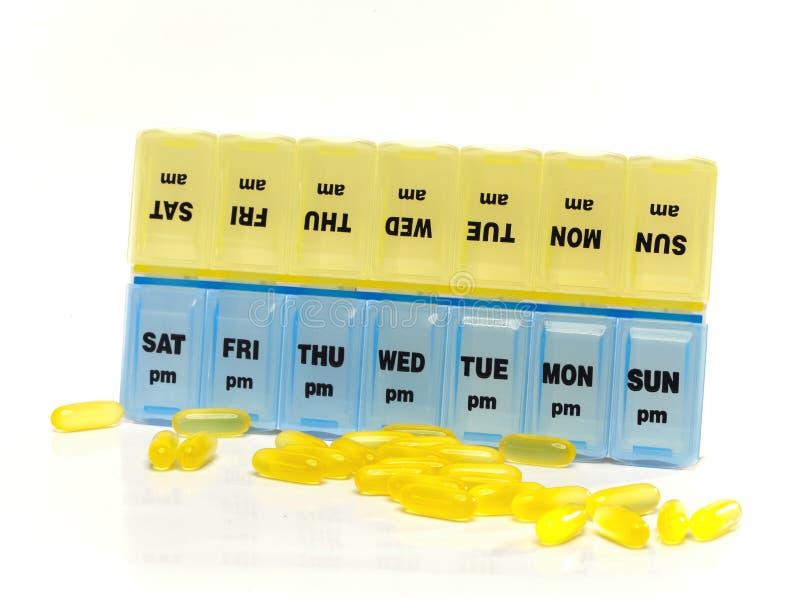 Caixa para o armazenamento das drogas, com inscrição em dias da semana fotografia de stock