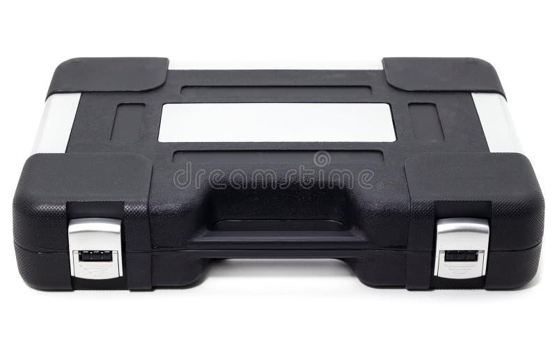 Caixa preta com um grupo de ferramentas automotivos em um fundo branco fotografia de stock
