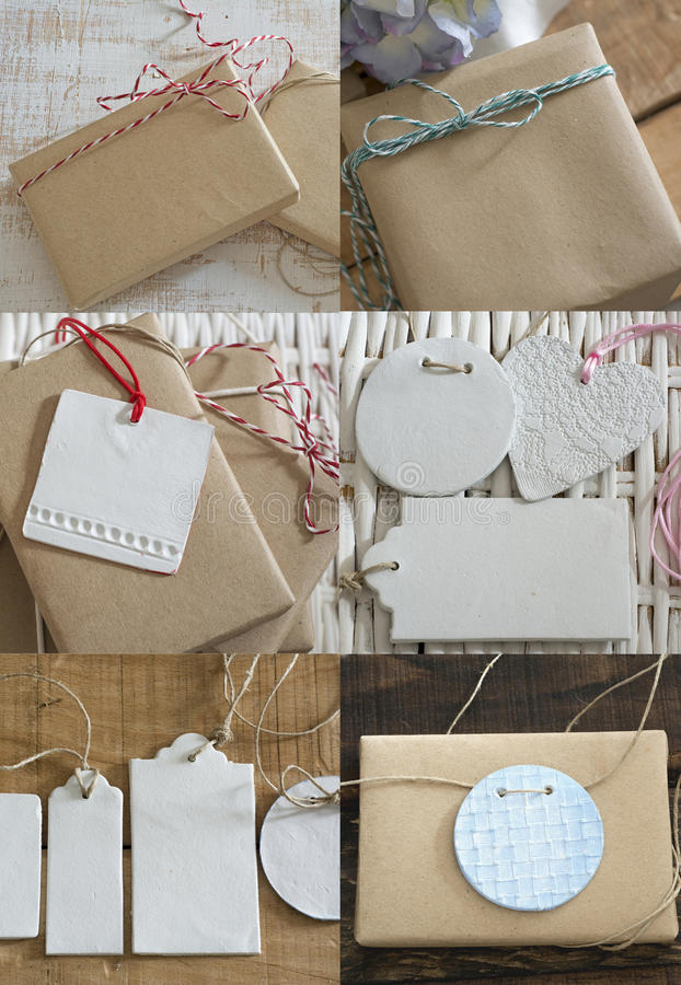 Caixas da coleção envolvidas no papel reciclado com etiqueta imagem de stock