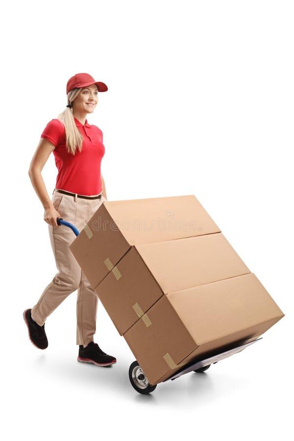 Caixas de fornecimento fêmeas com um caminhão de mão imagem de stock royalty free