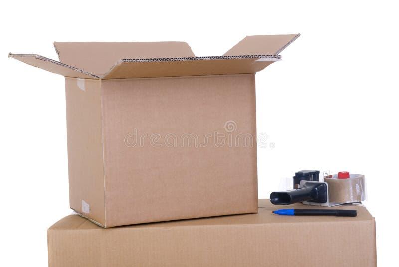 Caixas moventes foto de stock