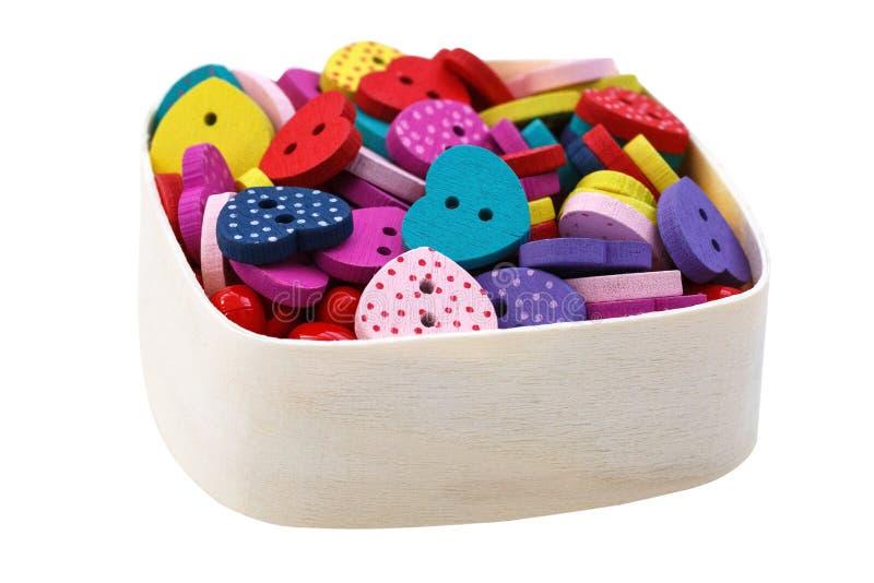 Caja con los botones en forma de corazón imagen de archivo libre de regalías