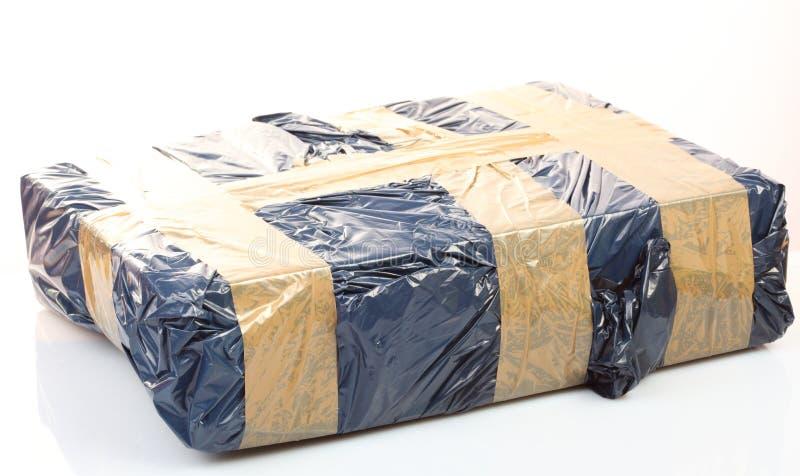 Caja de cartón con la cinta, conjunto seguro fotografía de archivo