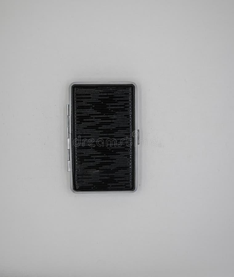 Caja de cigarrillo negra imagenes de archivo