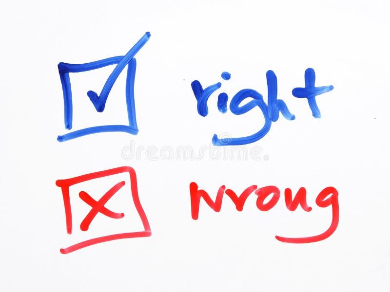 Caja de control de la escritura incorrecta o derecha en el fondo blanco fotografía de archivo libre de regalías