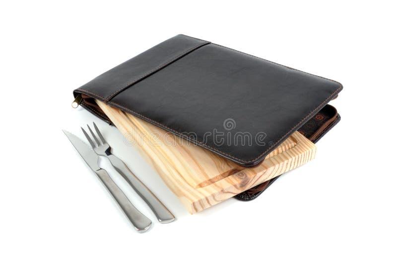 Caja de cuero y tabla de cortar aisladas fotografía de archivo