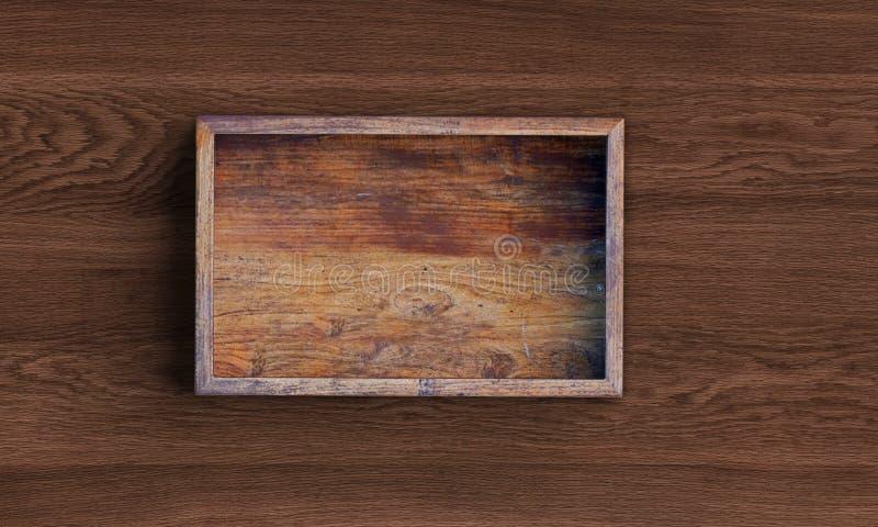Caja de madera cuadrada abierta en la tabla de madera representaci?n 3d libre illustration