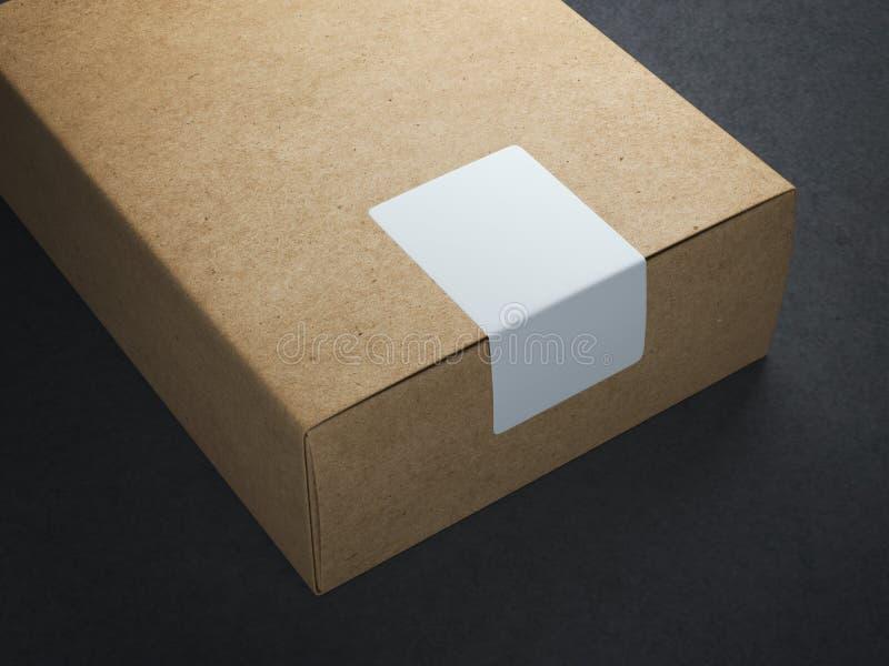 Caja de papel del arte con la etiqueta engomada blanca foto de archivo libre de regalías
