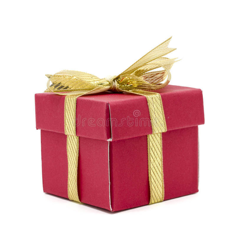 caja de regalo de la Navidad con un arco de la cinta del oro fotografía de archivo libre de regalías