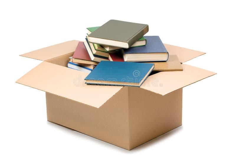 Caja y libros de cartón imagen de archivo