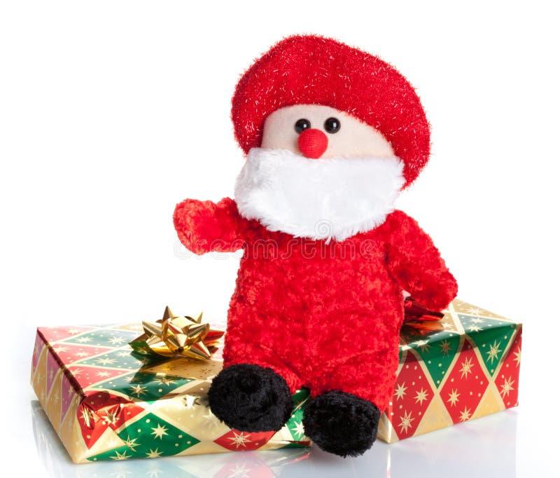 Cajas de regalo coloridas con la marioneta de Santa Claus imagenes de archivo