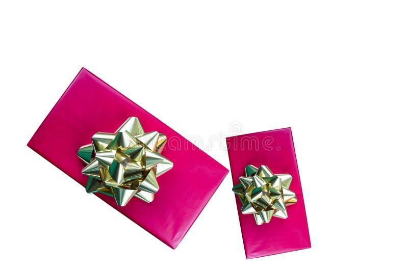 Cajas de regalo de vacaciones rojas aisladas en blanco foto de archivo