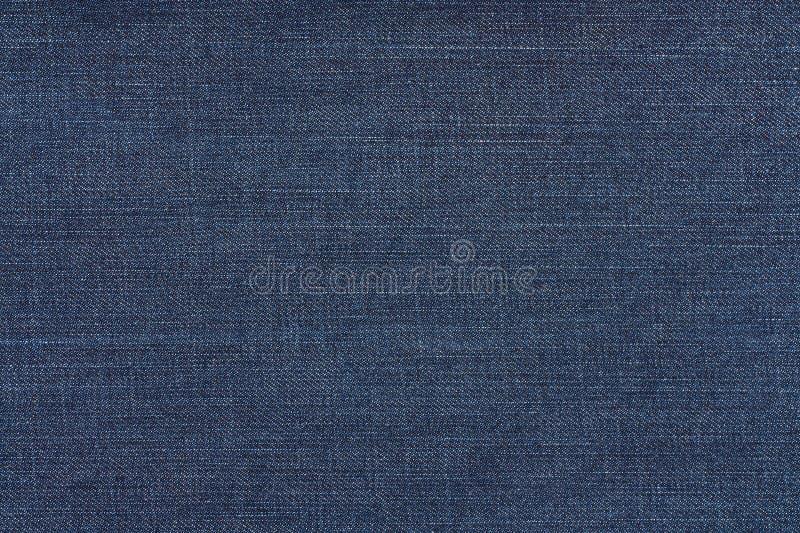 cajg błękitny ciemna tekstura Tkaniny drelichowy Tło obraz royalty free