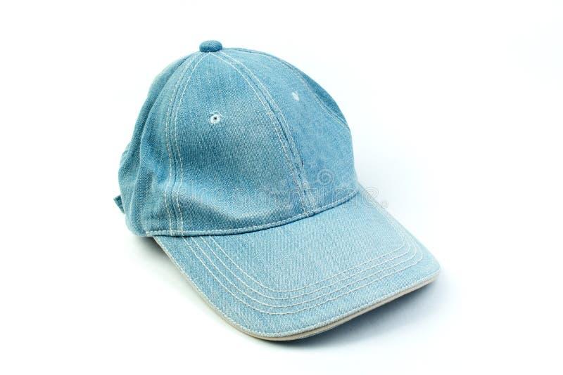 Cajgi nakrywają, błękitny drelichowy kapelusz na białym tle obraz royalty free