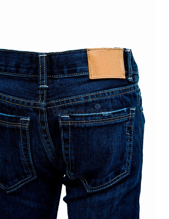 Cajgi, niebiescy dżinsy i biały tło, fotografia stock