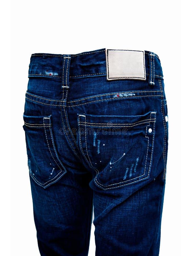 Cajgi, niebiescy dżinsy i biały tło, zdjęcia stock