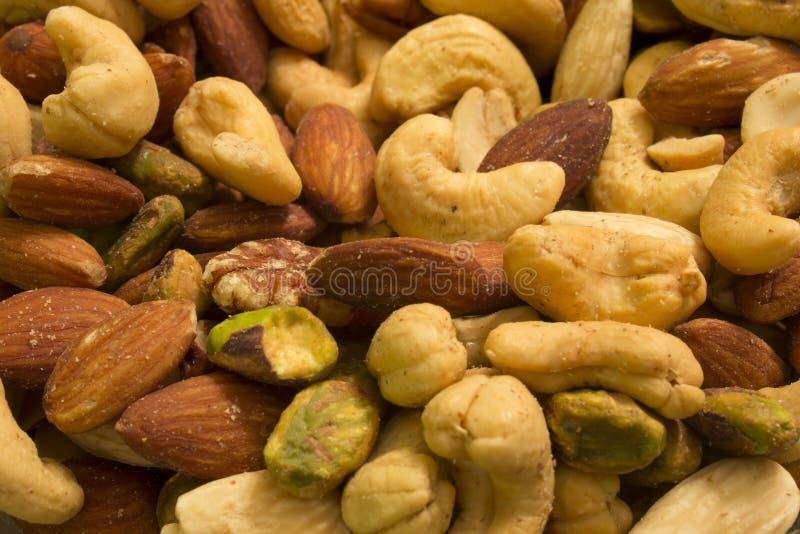 Cajus, amêndoas, pistaches e nozes-pecã imagem de stock royalty free