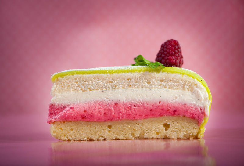 Cake. Slice of cake against pink background stock photos