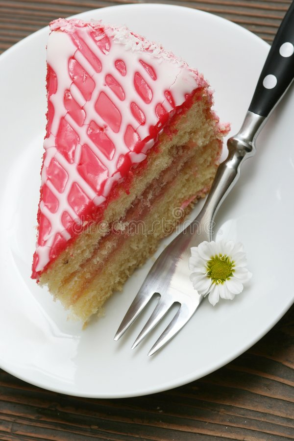 Cake. A slice of a cream cake and flowers royalty free stock photos