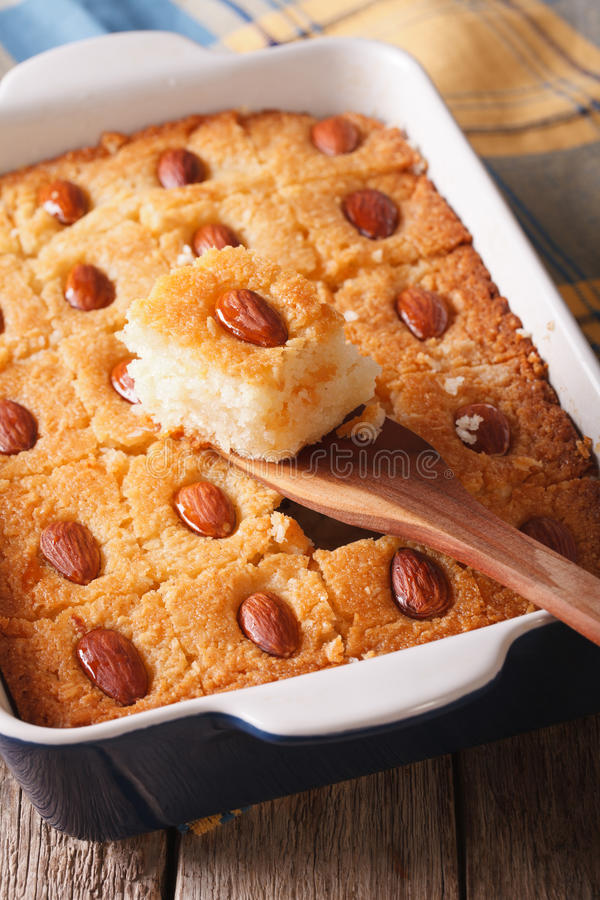Cake with almonds basbousa close up in baking dish. vertical royalty free stock images