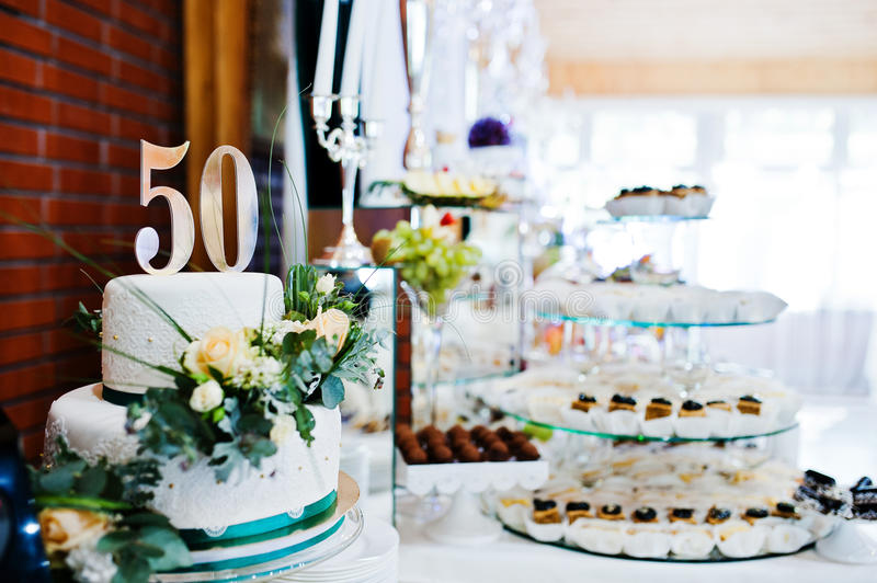 Cake anniversary in 50 at table.  stock photography