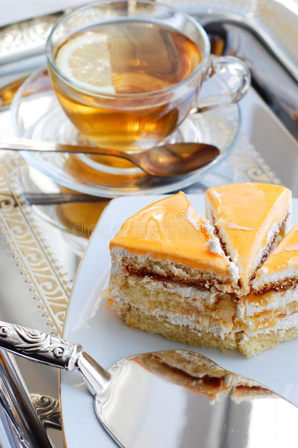 Download Cake With Apricot And Tea Royalty Free Stock Image - Image: 23386306